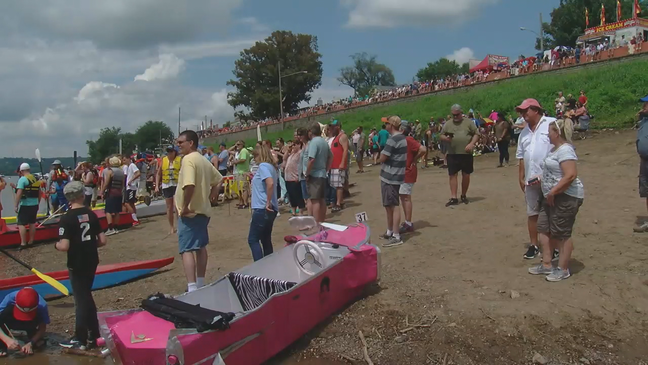 Boats at Cardboard Boat Regatta decorated in honor of Kyle