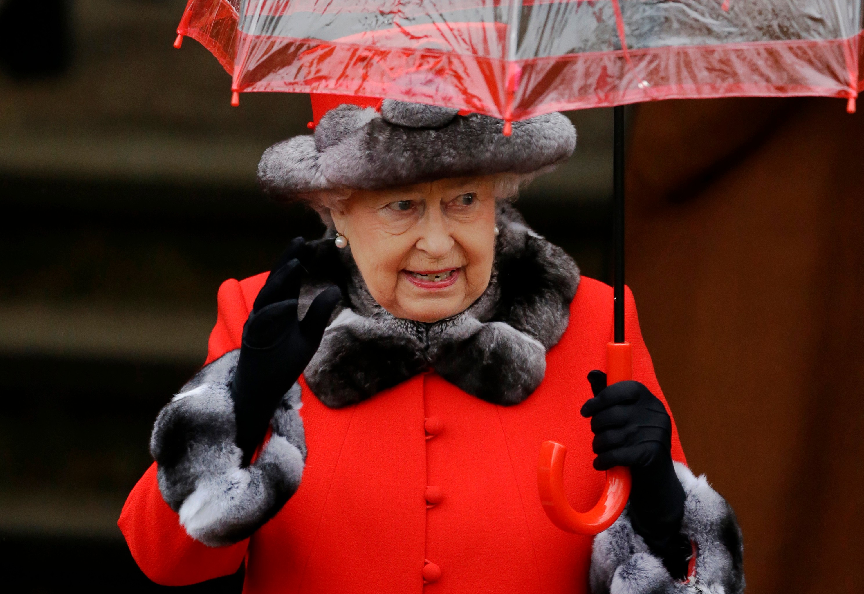 Britains Queen Elizabeth II Waves At The Crowd Of Well Wishers As She Leaves After